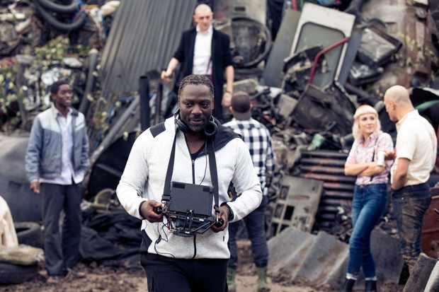Adewale Akinnuoye-Agbaje on set