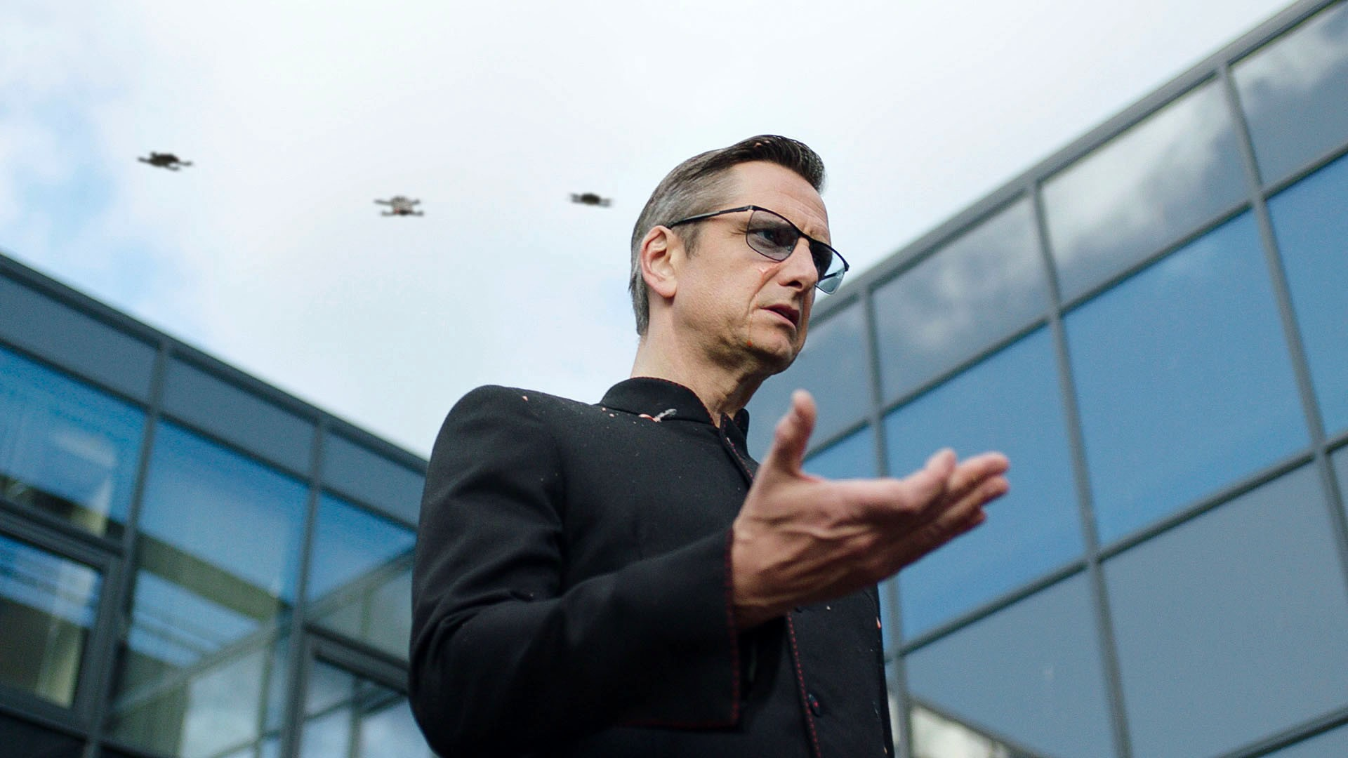 Programme Name: The Demon Headmaster - TX: 04/11/2019 - Episode: The Demon Headmaster - Ep 4 (No. 4) - Picture Shows: The Headmaster covered in Milkshake with Drones hovering behind The Headmaster (NICOLAS GLEAVES) - (C) BBC Studios - Photographer: n/a