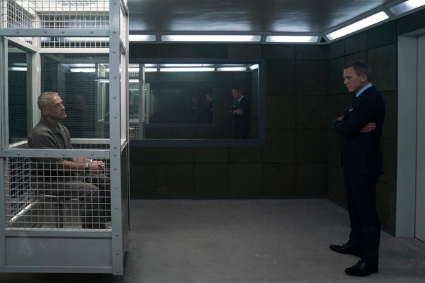 B25_16764_R James Bond (Daniel Craig) visits Blofeld (Christoph Waltz) in his prison cell in NO TIME TO DIE, a DANJAQ and Metro Goldwyn Mayer Pictures film. Credit: Nicola Dove © 2019 DANJAQ, LLC AND MGM. ALL RIGHTS RESERVED.