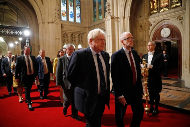 LONDON, ENGLAND - OCTOBER 14: British Prime Minister Boris Johnson (L) and main opposition Labour Party leader Jeremy Corbyn (R) head the procession of members of parliament through the Peers Lobby into the House of Lords to listen to the Queen's Speech during the State Opening of Parliament in the Houses of Parliament on October 14, 2019 in London, England. The Queen's speech is expected to announce plans to end the free movement of EU citizens to the UK after Brexit, new laws on crime, health and the environment. (Photo by Tolga Akmen - WPA Pool/Getty Images)