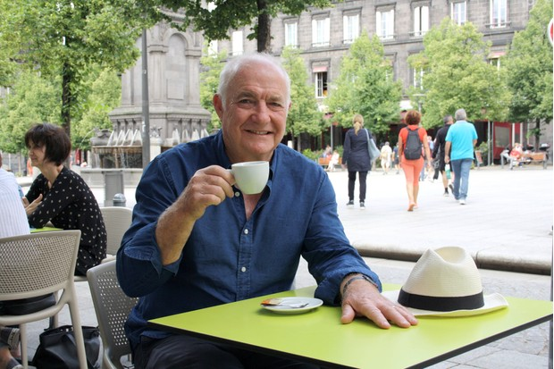 Programme Name: Rick Stein's Secret France - TX: n/a - Episode: n/a (No. 3) - Picture Shows: enjoying an al fresco café crème in the Auvergnat city of Clermont Ferrand Rick Stein - (C) Denham Productions - Photographer: Arezoo Farahzad