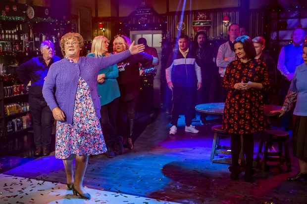 WARNING: Embargoed for publication until 00:00:01 on 07/12/2019 - Programme Name: Mrs Brown's Boys Christmas and New Year Special - TX: n/a - Episode: A Wonderful Mammy (No. 1 - A Wonderful Mammy) - Picture Shows: and cast in Foleys Bar.   **STRICTLY EMBARGOED NOT FOR PUBLICATION BEFORE 00:01 HRS ON SATURDAY 7TH DECEMBER 2019** Mrs Brown (BRENDAN O'CARROLL) - (C) BBC Studios - Photographer: Alan Peebles