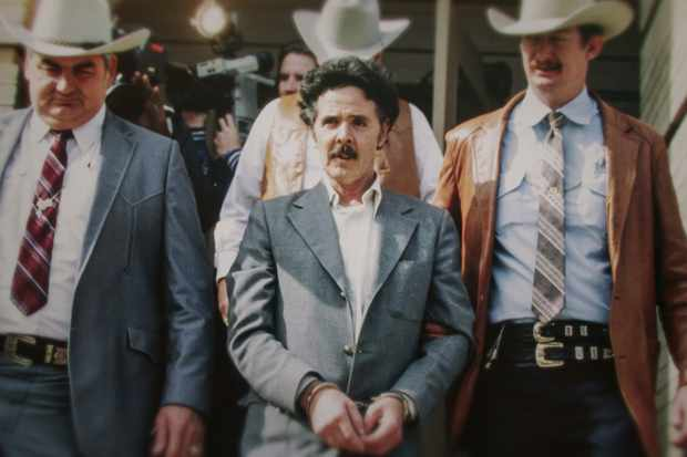 The Confession Killer —  Henry Lee Lucas (center) being escorted by Ranger Bob Prince (left) and task force