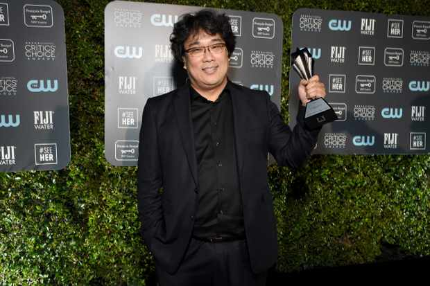SANTA MONICA, CALIFORNIA - JANUARY 12: Bong Joon-ho with the award for Best Director for 'Parasite' during the 25th Annual Critics' Choice Awards at Barker Hangar on January 12, 2020 in Santa Monica, California. (Photo by Michael Kovac/Getty Images for Champagne Collet)