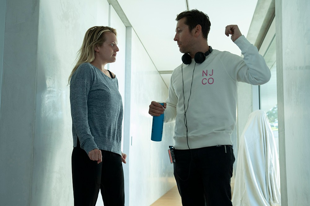 The Invisible Man director Leigh Whannell With Elisabeth Moss on set (Universal)