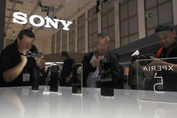 BERLIN, GERMANY - SEPTEMBER 05: Visitors look at the Sony Experia % Mobile Phone at the Sony Booth during the press day at the 2019 IFA home electronics and appliances trade fair on September 05, 2019 in Berlin, Germany. The 2019 IFA fair will be open to the public from September 6-11. (Photo by Michele Tantussi/Getty Images)