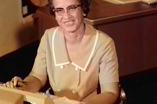 Portrait of NASA human computer and African-American mathematical pioneer Katherine Johnson (1918-2020) smiling, at a desk with notes, 1966. Image courtesy NASA. Note: Image has been digitally colorized using a modern process. Colors may not be period-accurate. (Photo by Smith Collection/Gado/Getty Images)