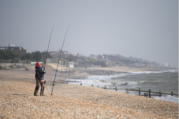 NORMAN BAY, ENGLAND - OCTOBER 04:  An angler prepares his equipment on the beach at Norman Bay, along the coast from the beach which is widely believed to be the location of William the Conquerer's landing, on October 4, 2016 in Pevensey, England. With the 950th anniversary of 1066, the Battle of Hastings and the Norman Conquest approaching, English Heritage, local groups and businesses are preparing to mark the historic invasion with re-enactments, tours and concerts.  (Photo by Leon Neal/Getty Images)