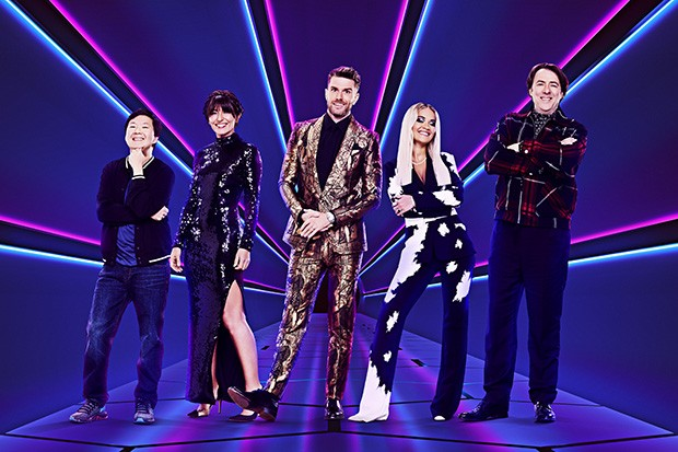 From Bandicoot TV  The Masked Singer on ITV  Pictured: Ken Jeong, Davina McCall, Joel Dommett, Rita Ora and Jonathan Ross.  This photograph is (C) ITV/Bandicoot TV and can only be reproduced for editorial purposes directly in connection with the programme or event mentioned above, or ITV plc. Once made available by ITV plc Picture Desk, this photograph can be reproduced once only up until the transmission [TX] date and no reproduction fee will be charged. Any subsequent usage may incur a fee. This photograph must not be manipulated [excluding basic cropping] in a manner which alters the visual appearance of the person photographed deemed detrimental or inappropriate by ITV plc Picture Desk.  This photograph must not be syndicated to any other company, publication or website, or permanently archived, without the express written permission of ITV Picture Desk. Full Terms and conditions are available on the website www.itv.com/presscentre/itvpictures/terms  For further information please contact: james.hilder@itv.com / 0207 157 3052