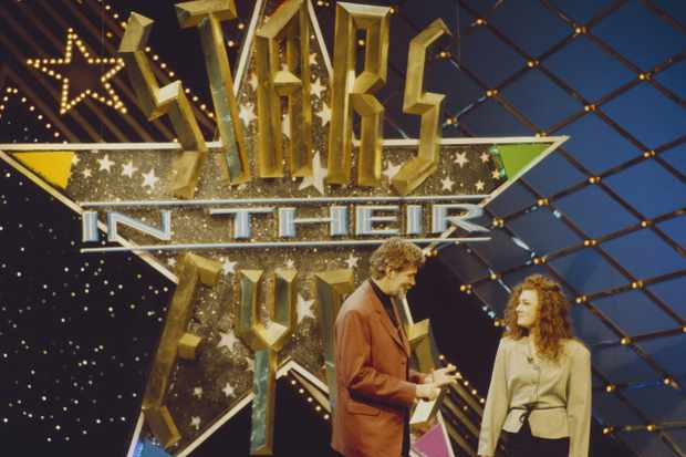UNITED KINGDOM - JANUARY 01:  GRANADA TELEVISION  Photo of Matthew KELLY, host Matthew Kelly with contestant on set of Stars In Their Eyes TV show  (Photo by Phil Dent/Redferns)