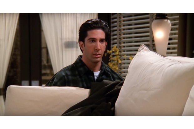 Ross is carrying a couch and looking worried