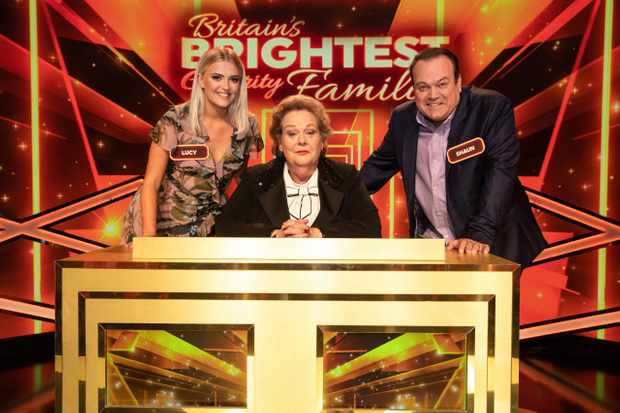 From Gameface Productions  BRITAINS BRIGHTEST CELEBRITY FAMILY Thursday 28th May 2020 on ITV   Pictured: (l-r) Lucy Fallon, host Anne Hegerty and Shaun Williamson  Quiz battle axe The Governess, aka Anne Hegerty, hosts a quiz in which eight celebrity families take part in a knock out tournament as they attempt to win £25,000 for their chosen charity and the title of BritainÕs Brightest Celebrity Family.  Filmed before lockdown, tonights heat is a soap special as Shaun Williamson and family take on Lucy Fallon and family in an 'Eastenders v Corrie' contest  (c) Gameface Productions  For further information please contact Peter Gray 0207 157 3046 peter.gray@itv.com    This photograph is (C) Gameface Productions  and can only be reproduced for editorial purposes directly in connection with the  programme  BRITAINS BRIGHTEST CELEBRITY FAMILY or ITV. Once made available by the ITV Picture Desk, this photograph can be reproduced once only up until the Transmission date and no reproduction fee will be charged. Any subsequent usage may incur a fee. This photograph must not be syndicated to any other publication or website, or permanently archived, without the express written permission of ITV Picture Desk. Full Terms and conditions are available on the website https://www.itv.com/presscentre/itvpictures/terms