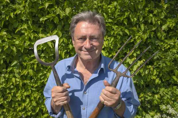 From Spungold Productions  GROW YOUR OWN AT HOME WITH ALAN TITCHMARSH Monday 25th May 2020 on ITV   Pictured: Alan Titchmarsh in his garden ..picture taken by his wife Alison   In a brand new series for ITV Grow Your Own at Home with Alan Titchmarsh sees the much-loved gardener share insider tips and tricks on growing your own fruit and vegetables at home.   Filmed by his wife Alison while in lockdown, this series sees Alan show viewers how to enjoy the benefits of producing their own food no matter what size garden they have; be it outside space, a balcony or room for a single pot.   Plus, holed up in their own very different gardens, the Love Your Garden team - David Domoney, Katie Rushworth and Frances Tophill - are also working on their own plots to turn them into productive gardens. Whether that's creating a veg patch from scratch, a tiny edible terraced garden or making an indoor pizza-themed herb garden for the kitchen.   These sequences will be interspersed with archive footage revealing Alan's experiences of veg gardens, including inspirational growers and stunning gardens from across the country over the past ten years.   Where possible the team will be working in real time so the audience can start working on their new gardens at the same time.   With health and food supply high on the agenda it's the perfect time to grow your own.   © Spungold  For further information please contact Peter Gray 0207 157 3046 peter.gray@itv.com    This photograph is © Spungold and can only be reproduced for editorial purposes directly in connection with the  programme GROW YOUR OWN AT HOME WITH ALAN TITCHMARSH or ITV. Once made available by the ITV Picture Desk, this photograph can be reproduced once only up until the Transmission date and no reproduction fee will be charged. Any subsequent usage may incur a fee. This photograph must not be syndicated to any other publication or website, or permanently archived, without the express written permission of ITV Picture