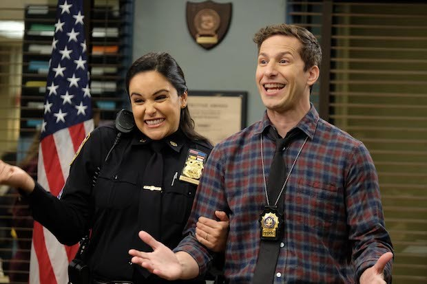 Melissa Fumera as Amy Santiago and Andy Samberg as Jake Peralta