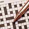 Crossword puzzle and pen