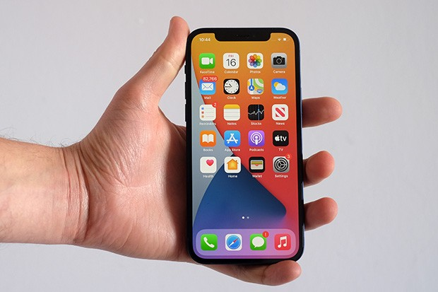 iPhone 12 in a hand