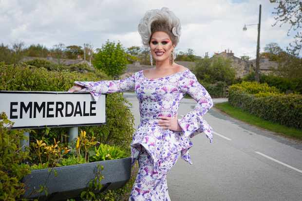 FROM ITV  STRICT EMBARGO - No Use Before Tuesday 25th May 2021  THE VIVIENNE JOINS EMMERDALE FOR PRIDE CELEBRATION   Emmerdale villagers will be celebrating Pride next month and who better to join the cast for the day than Drag Race UKÕs first winner, The Vivienne.  Playing her fabulous self, The Vivienne will make an appearance at EmmerdaleÕs first Pride day, which will see the village church and LGBTQ+ communities join forces for a day of celebration.   ÒI am so happy that I will be part of Emmerdale's first ever Pride,Ó commented The Vivienne.  ÒMy role is to officially open the event on the stage! It's great for Emmerdale to be doing this and IÕm delighted to be part of it. WeÕre making that little bit of history for all the gays and the LGBTQ+ community and itÕs just an absolute honour,Ó she added.   Emmerdale producer, Kate Brooks said:   Ô'We're absolutely thrilled to welcome The Vivienne to Emmerdale to help our villagers celebrate this year's Pride event in style. The Vivienne will add a dash of her own inimitable wit and fabulousness to the show and will certainly raise a few eyebrows in the process.Ó  Viewers will be able to see The VivienneÕs appearance on screen at the end of June.  Picture contact David.crook@itv.com   This photograph is (C) ITV Plc and can only be reproduced for editorial purposes directly in connection with the programme or event mentioned above, or ITV plc. Once made available by ITV plc Picture Desk, this photograph can be reproduced once only up until the transmission [TX] date and no reproduction fee will be charged. Any subsequent usage may incur a fee. This photograph must not be manipulated [excluding basic cropping] in a manner which alters the visual appearance of the person photographed deemed detrimental or inappropriate by ITV plc Picture Desk. This photograph must not be syndicated to any other company, publication or website, or permanently archived, without the express written permission of ITV Picture Desk. Full Terms and conditions are available on  www.itv.com/presscentre/itvpictures/terms