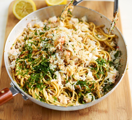 Prawn linguine with chilli, breadcrumbs and parsley in a wide pan