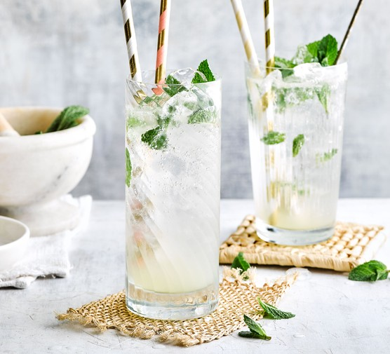 Virgin mojito mocktails in glasses with paper straws