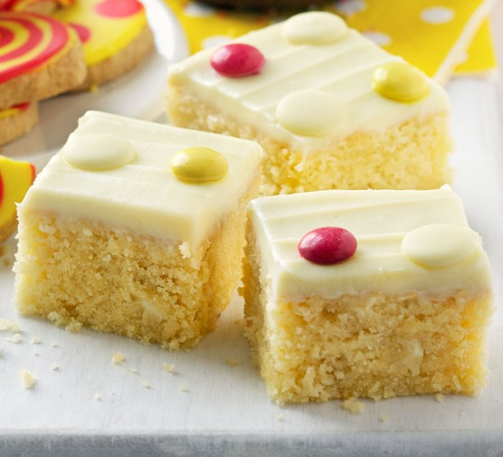 White chocolate cake with icing and sweets