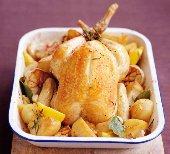 Slow roast chicken and potatoes in a baking dish