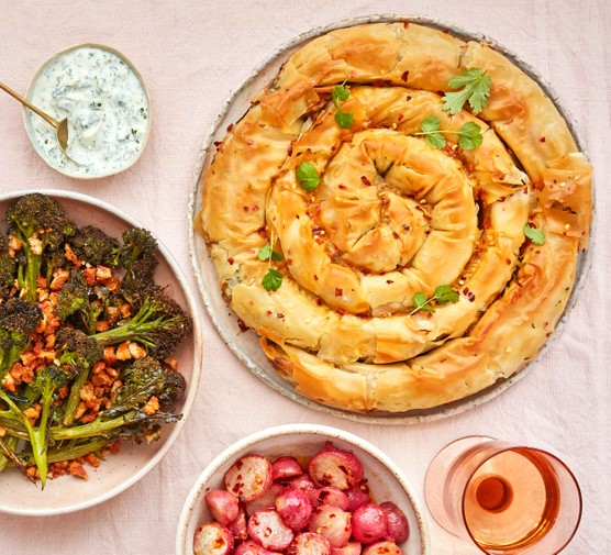 Filo pastry swirl served with sides of broccoli and radishes