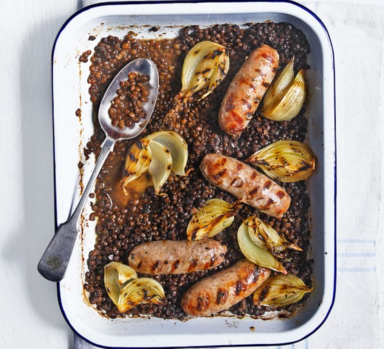 Sausage and lentils in tray with spoon
