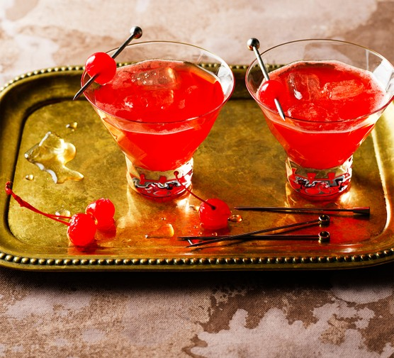 Mai tai cocktails in glasses with cherry garnish