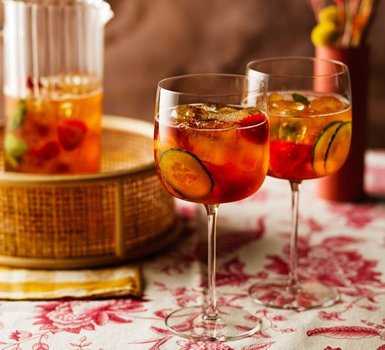 Pimm's in glasses with fruit and cucumber