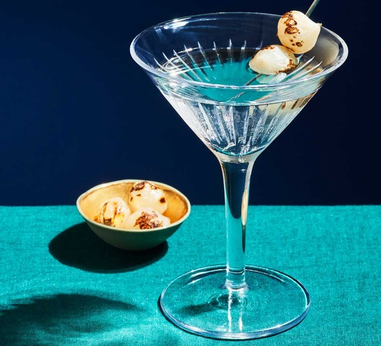 Gibson cocktail in glass with pearl onions