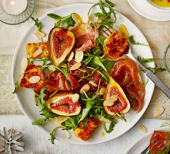 Fig, halloumi and lettuce leaf salad on a plate