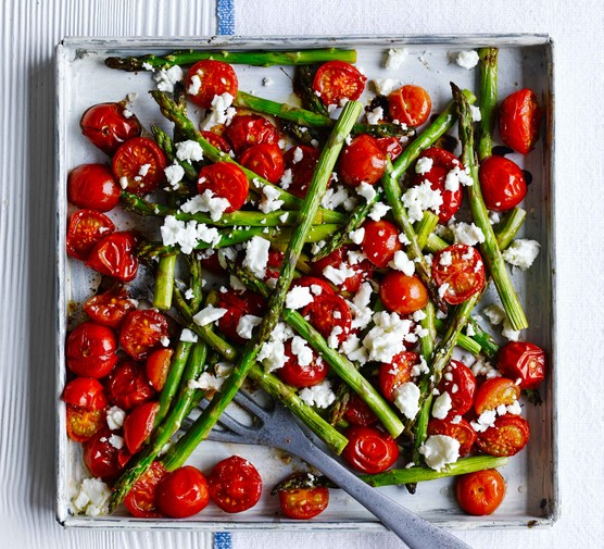 Cherry tomatoes with asparagus on tray