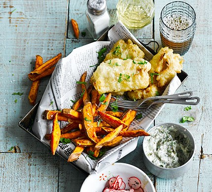 fried fish and sweet potato chips in a newspaper basket