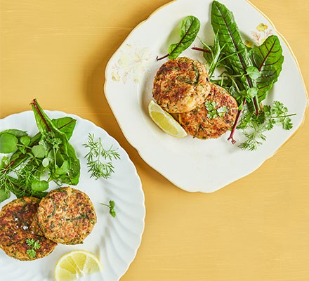 Jersey Royal crab cakes on plate with salad