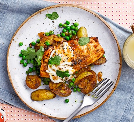 tandoori trout on top of peas and potatoes
