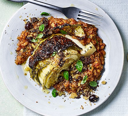 Italian-style roast cabbage wedges with tomato lentils served on a plate