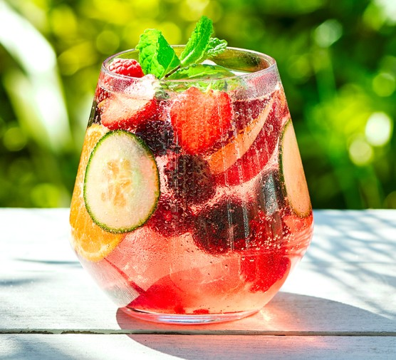 Summer mocktail in glass with fruit and ice