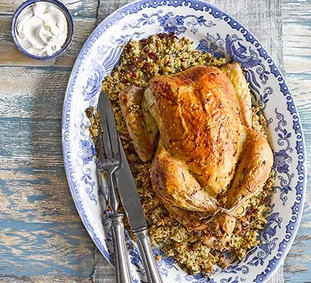 Saffron butter chicken with date and couscous stuffing served on a plate