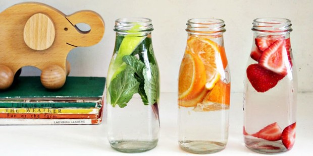 Three bottles of water with fruit infused