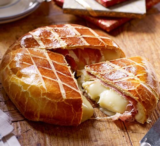 Cheesy brioche bake with slice cut