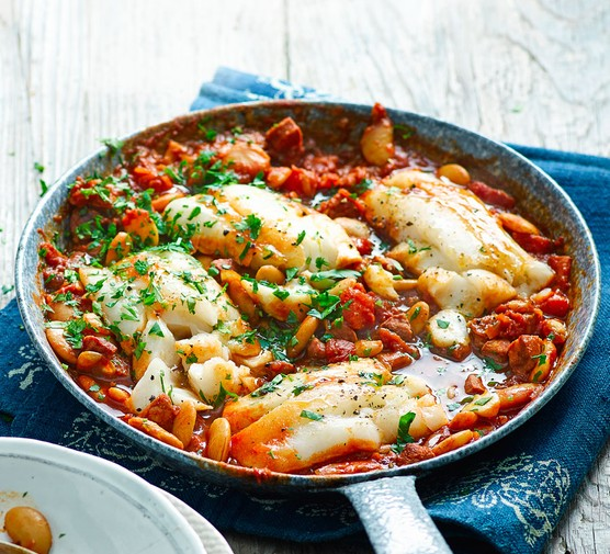 Cod and bean stew in pan