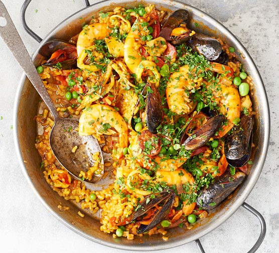 Seafood paella in dish with spoon