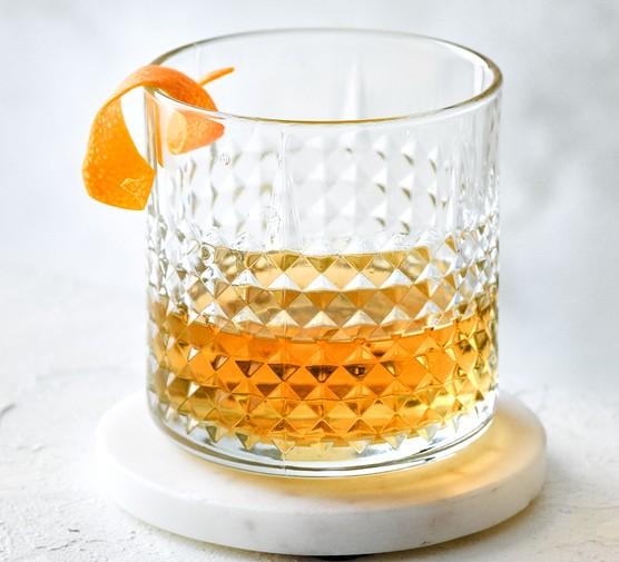 Sazerac in glass with orange peel garnish