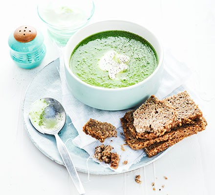 A bowl of cucumber, pea & lettuce soup with bread