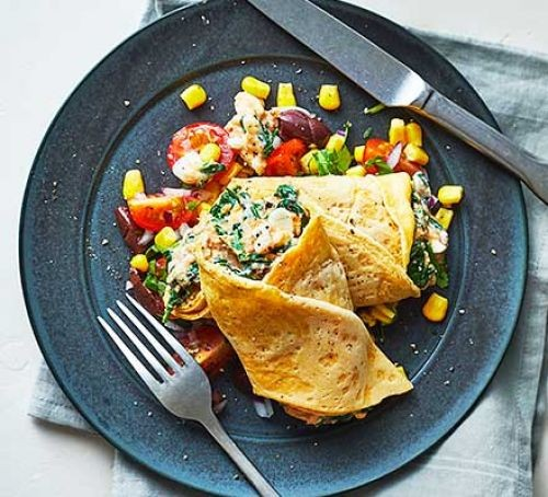 Spinach and tuna rollup pancakes on a plate