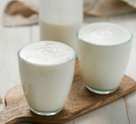 Milk kefir in glasses on a board