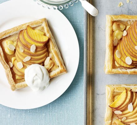 Square peach tarts with ice cream on a plate