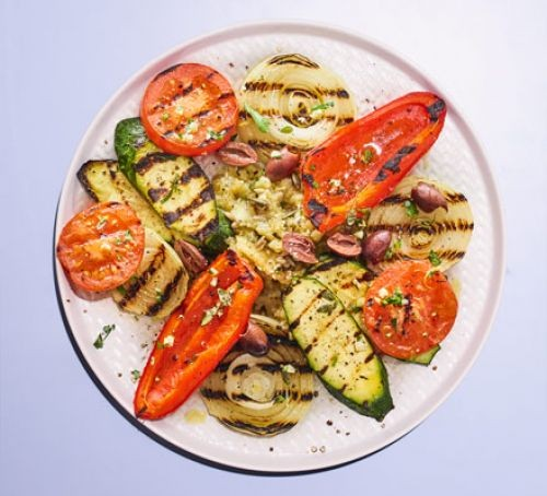 Griddled aubergines, courgettes, pepper and tomatoes on a plate
