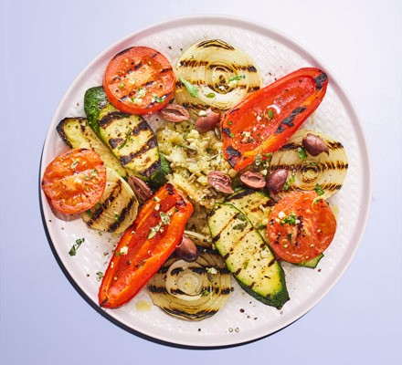 A plate of griddled vegetables including tomatoes, courgettes, peppers and aubergine