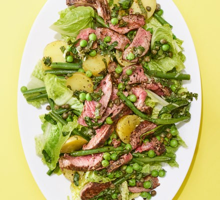 A green bean, potato and lettuce salad with seared beef steak and mint